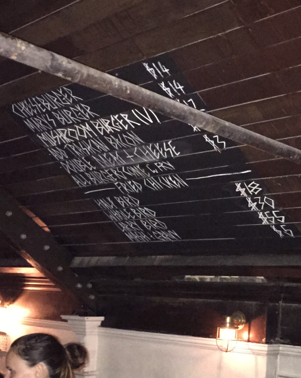 Saving trees by putting the menu on the ceiling. Short and to the point!